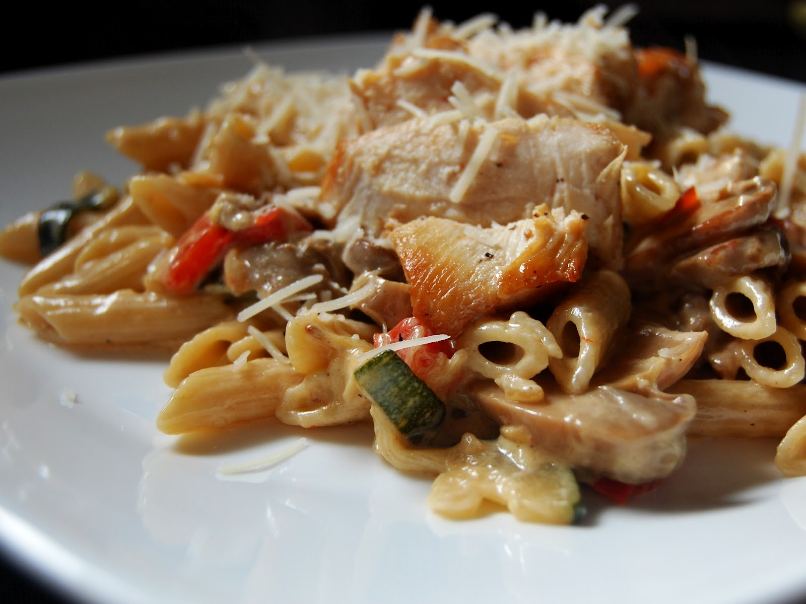 chicken and vegetable pasta with roasted garlic cream sauce